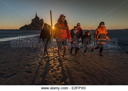 France Manche Bay of Mont Saint Michel listed as World Heritage by UNESCO The Mont Saint Michel Crossing the Bay - Stock Photo