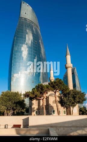 Azerbaijan Baku Flame Towers by architects Hellmuth Obata & Kassabaum Shehidler mosque - Stock Photo