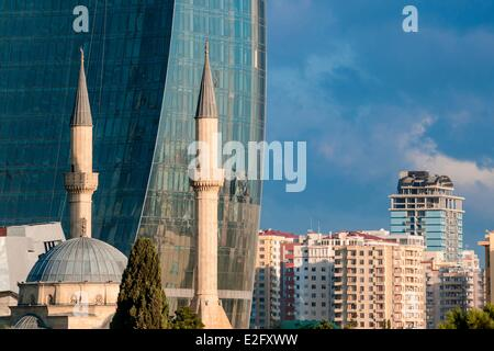 Azerbaijan Baku Flame Towers by architects Hellmuth Obata & Kassabaum and Shehidler mosque - Stock Photo