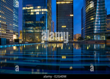 Modern buildings and reflections in La Defense district, Paris France - Stock Photo