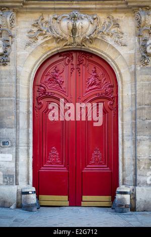 Ornate wooden doors in the Marais district, Paris France - Stock Photo