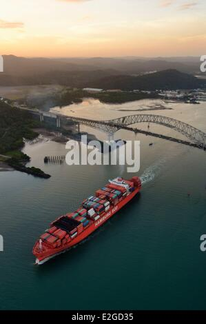 Panama Panama City Panama Canal entrance on Pacific Ocean side a Panamax container cargo passing under Bridge of - Stock Photo