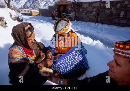 Pakistan Khyber Pakhtunkhwa Kalash valleys Bumburet valley Krakal village (2150m) young mother presenting her baby - Stock Photo