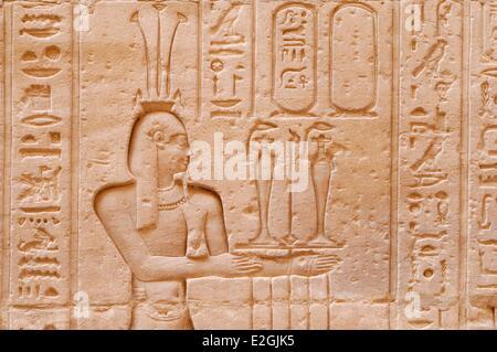 Egypt Upper Egypt Edfu Edfu Temple or Temple of Horus exterior corridor engravings and hieroglyphs - Stock Photo