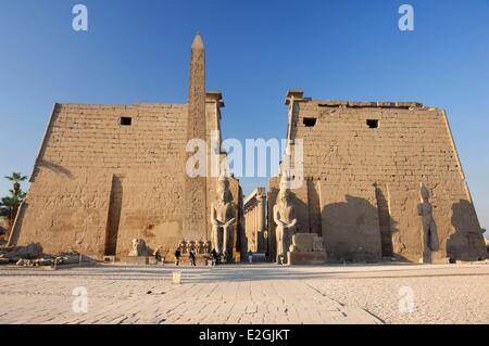 Egypt Upper Egypt Luxor temple listed as a World Heritage by UNESCO pylon of Ramses II obelisk and statues of Ramses - Stock Photo