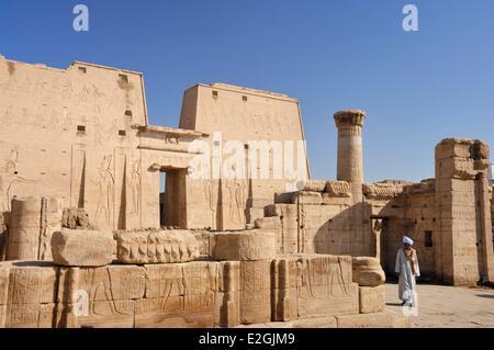 Egypt Upper Egypt Edfu Edfu Temple or Temple of Horus man before pylon 36m high - Stock Photo