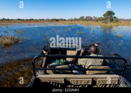 Botswana North West District Okavango Delta Abu Lodge crossing of swamps with 4x4 - Stock Photo