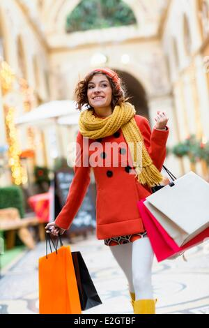 France Paris Woman shopping in Galerie Vivienne - Stock Photo