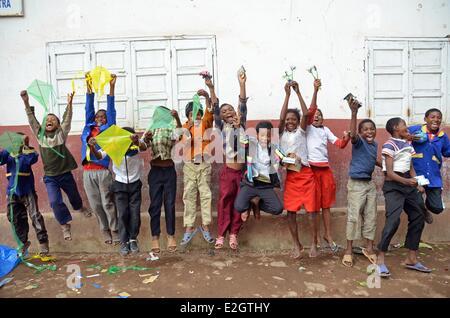 Madagascar Antananarivo schoolchildren jumping in air - Stock Photo