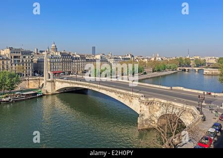 France Paris banks of Seine river listed as World Heritage by UNESCO river Seine with Pont de Tournelle between - Stock Photo
