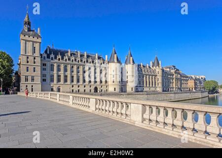 France Paris banks of Seine river listed as World Heritage by UNESCO Conciergerie on Ile de la Cite and Pont au - Stock Photo