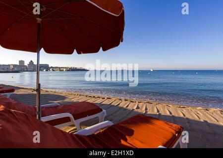 France Var Frejus deckchairs and parasols on Frejus beach seen on Saint Raphael - Stock Photo