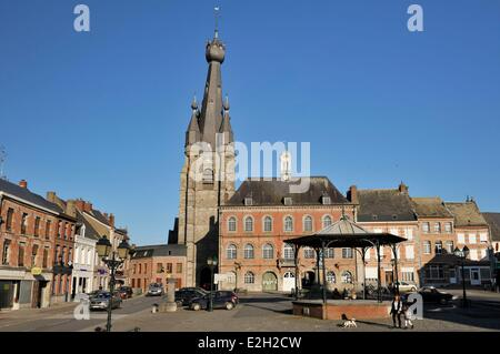 France Nord Solre le Chateau Grand Place Saint Pierre Saint Paul's church with its characteristic leaning bell tower - Stock Photo