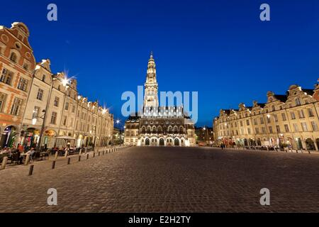 France Pas de Calais Arras Place des Heros Town Hall at night topped with its 77 meters belfry listed as World Heritage - Stock Photo