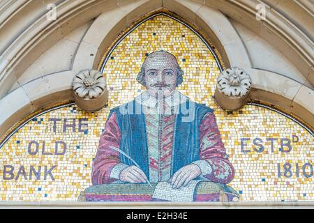 United Kingdom Warwickshire Stratford-upon-Avon Old Bank 1883 and pediment with a mosaic representing William Shakespeare - Stock Photo