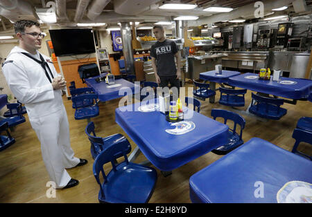 Vancouver, Canada. 19th June, 2014. Crew members take a break inside the USS Decatur in Vancouver, Canada, June - Stock Photo