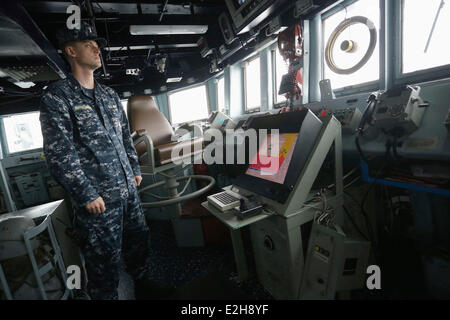 Vancouver, Canada. 19th June, 2014. A crew member executes his duty inside the cabin of the USS Decatur in Vancouver, - Stock Photo