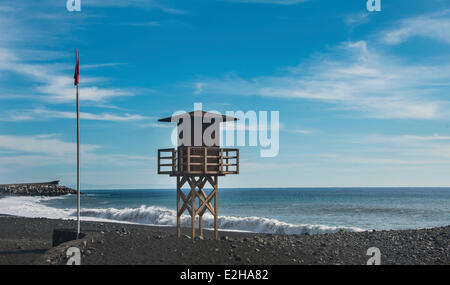 Watch tower on the beach, red flag, Tazacorte, La Palma, Canary Islands, Spain - Stock Photo