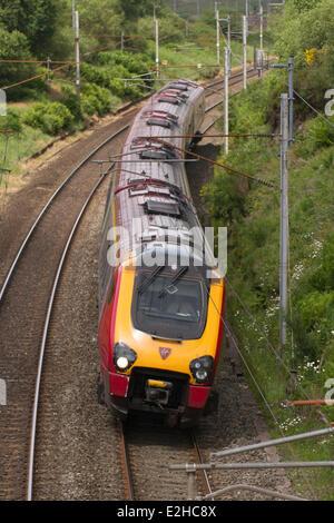 Virgin Train West Coast Line Franchise renewed.  Traveling Virgin Pendolino and Voyager Passenger Trains at Shap, - Stock Photo
