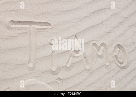 'ti amo' Italian 'i love you' text written sand texture textured dune beach background - Stock Photo