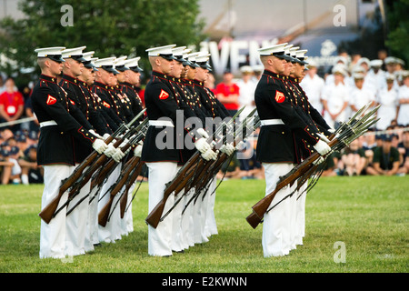 The US Marine Corps Silent Drill Platoon performs their drills during the Sunset Parade at the Iwo Jima Memorial - Stock Photo