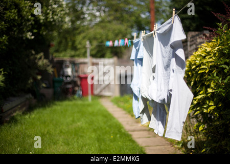 Clothes on washing line summer - Stock Photo