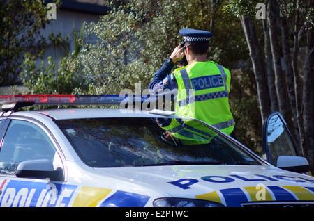 Traffic Police officer pointing his radar gun at speeding traffic. - Stock Photo