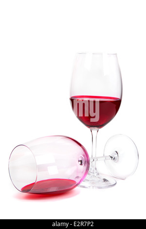 two glass of red wine on a white background one of them lies