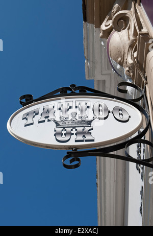 sign for a branch of tattoo uk, twickenham, middlesex, england, one of a small chain of tattooists shops in the - Stock Photo