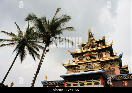 Golden temple at Tibetan monastery in South India - Stock Photo