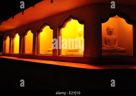 Buddhas in shrine under Bodhi tree - Stock Photo
