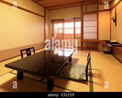Traditional Japanese room with chabudai tea table at a ryokan hotel in Japan. - Stock Photo