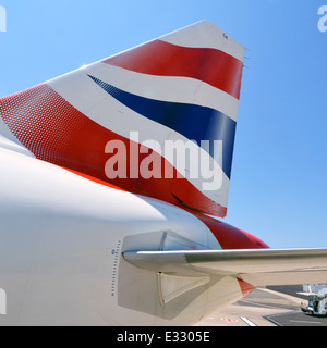 Close up of British Airways corporate logo on aircraft tail fin - Stock Photo