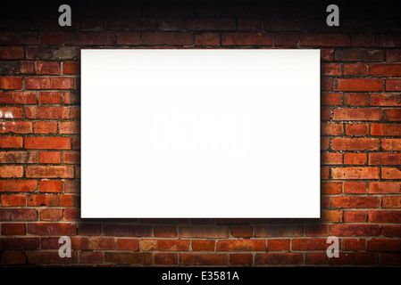 Blank poster on old brick wall. Outdoor advertising copy space. - Stock Photo