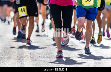 Close-up of runners legs and feet in 5K & 10K foot races, annual FIBark festival, Salida, Colorado, USA - Stock Photo