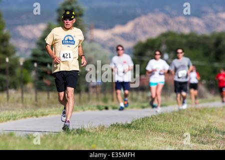 Runners race in 5K & 10K foot races, annual Fibark festival, Salida, Colorado, USA - Stock Photo