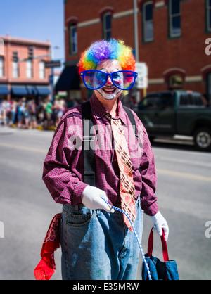 Clown in annual FIBark Parade in small mountain town of Salida, Colorado, USA - Stock Photo