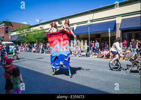 Circus performers on stilts in Annual FIBark Parade in small mountain town of Salida, Colorado, USA - Stock Photo