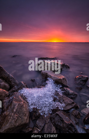 The last ice remains from winter on Lake St. Clair, Michigan.  Winter ice cover is being influenced by climate change - Stock Photo