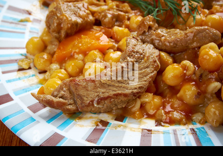 Cholent or Hamin - is a traditional Jewish stew. basic ingredients of cholent are meat, potatoes, beans and barley. - Stock Photo