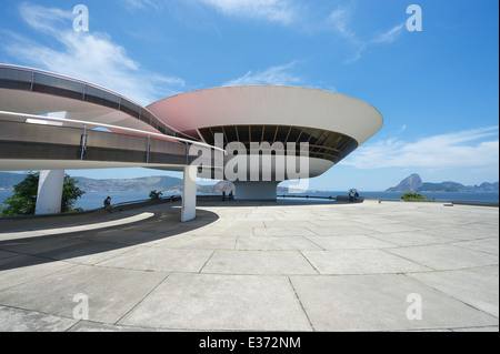 RIO DE JANEIRO, BRAZIL - FEBRUARY 4, 2014: The modernist Niteroi Contemporary Art Museum (MAC) by Oscar Niemeyer. - Stock Photo
