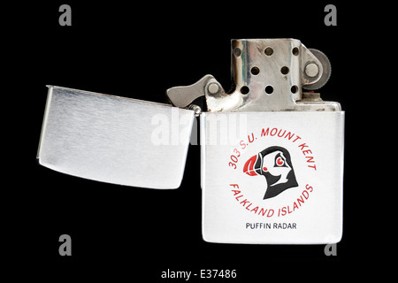 Very rare cigarette lighter by Zippo from 1982, bearing the message 'Falkland Islands, 303 S.U. Mount Key, Puffin - Stock Photo