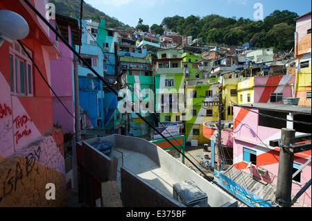 RIO DE JANEIRO, BRAZIL - FEBRUARY 14, 2014: Graffiti decorates the colorful painted buildings at Favela Santa Marta. - Stock Photo