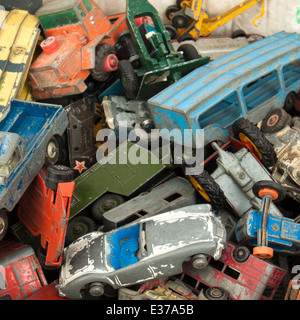 Collection of vintage well-used diecast toy cars by Corgi, Matchbox and Dinky - Stock Photo
