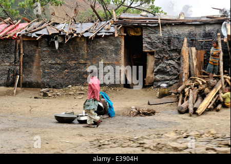 Immigrant children play by dwellings of immigrants from Nepal, locally known as Lhotshampa, who work maintaining - Stock Photo
