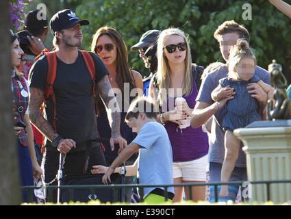 David and Victoria Beckham spend quality time with their kids at Disneyland. The famous family spent lots of time - Stock Photo