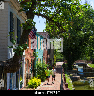 Washington DC. Runners on the Chesapeake and Ohio Canal towpath in downtown Georgetown, Washington DC, USA - Stock Photo