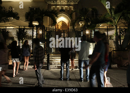 People gather outside the former residence of designer Gianni Versace on South Beach. - Stock Photo