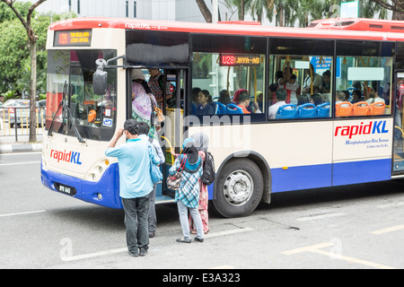 Passengers on a commuter bus in central Kuala Lumpur, Malaysia - Stock Photo