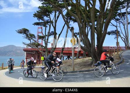 cyclists ride on golden gate bike path across bridge to sausalito - Stock Photo